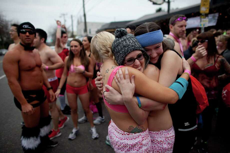 Sarah Englund, center, Amber Barrett and Kristi Grinnell, right, try to keep warm during Cupid's Undie Run. It was a chilly day to be outside in your undies. Photo: JOSHUA TRUJILLO, SEATTLEPI.COM / SEATTLEPI.COM