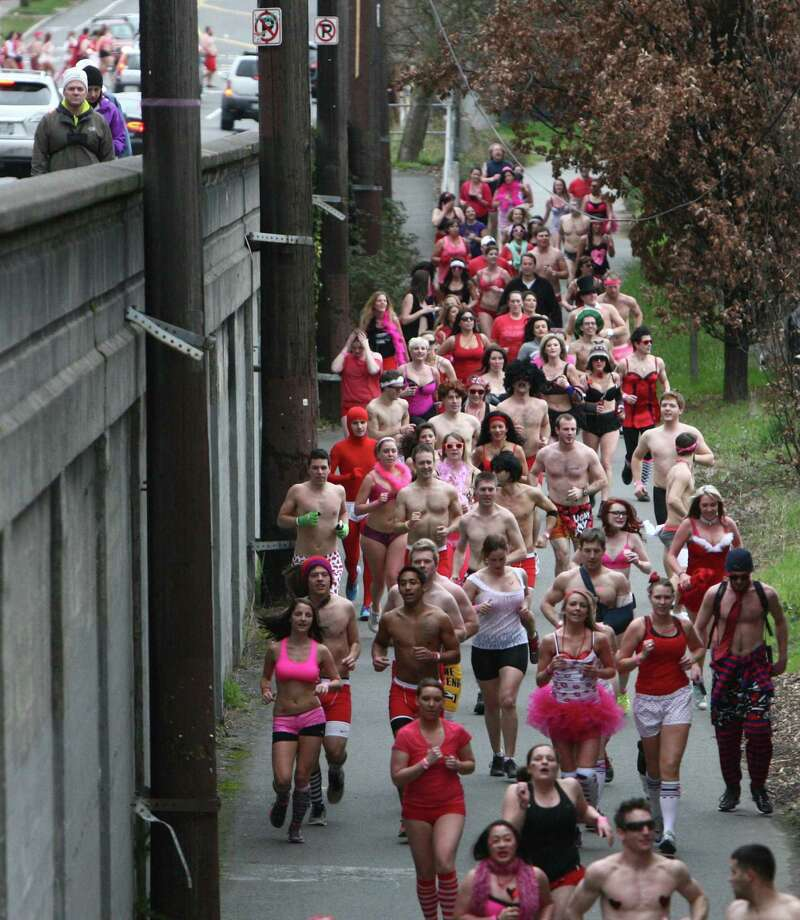 Participants run on the Burke-Gilman Trail during Cupid's Undie Run. Some passersby were shocked to see the large crowd of people in their undies. Others expect nothing less in Seattle's quirky Fremont neighborhood. Photo: JOSHUA TRUJILLO, SEATTLEPI.COM / SEATTLEPI.COM