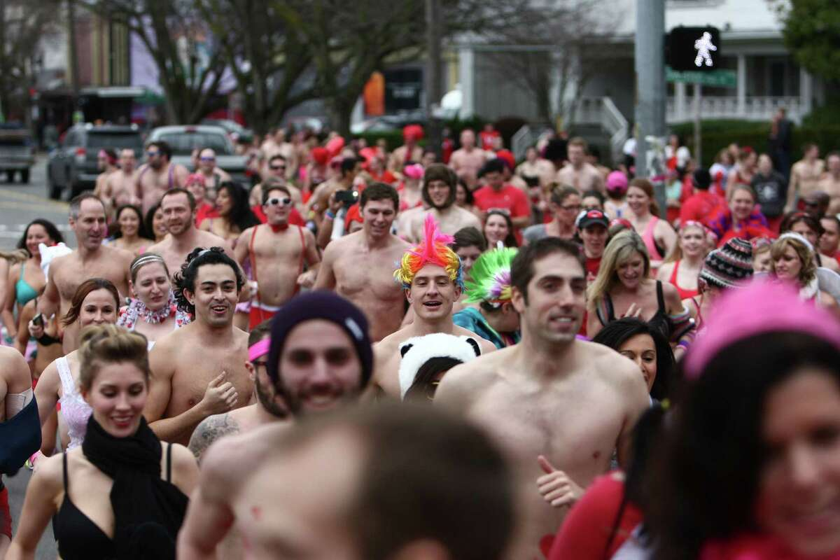 Participants run through Fremont during Cupid's Undie Run on Saturday, February 9, 2013 in Seattle's Fremont neighborhood. Hundreds of people gathered at the Ballroom and then completed a roughly mile-long run in their skivvies. The event was a fundraiser for The Children's Tumor Foundation.