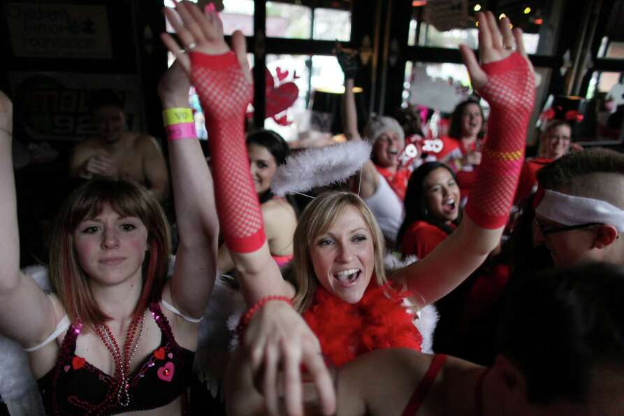 Participants celebrate as fund-raising totals are announced during Cupid's Undie Run. The money rais