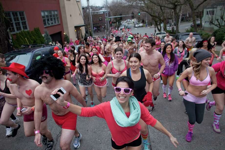 Runners make their way along North 36th Street during Cupid's Undie Run. Photo: JOSHUA TRUJILLO, SEATTLEPI.COM / SEATTLEPI.COM