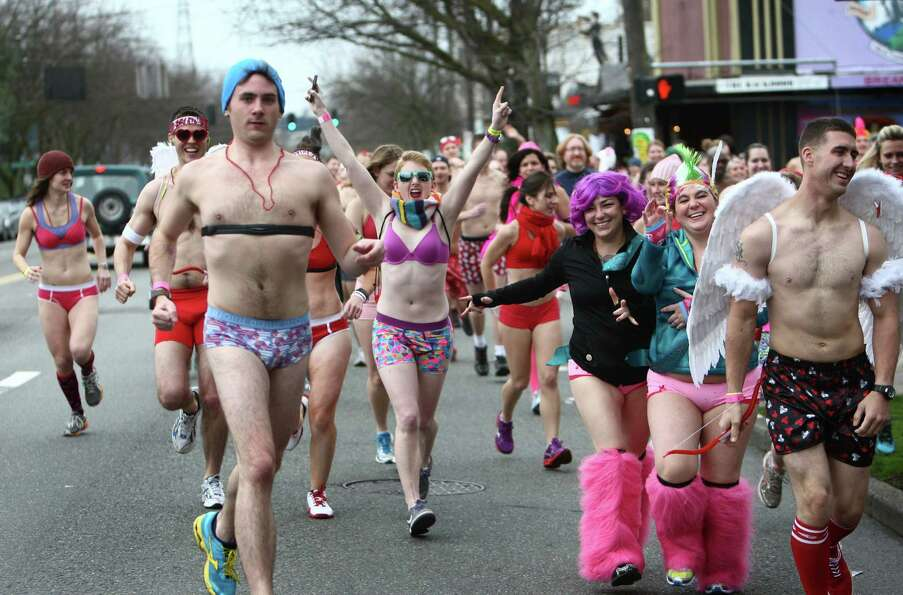 Participants run through Fremont during Cupid's Undie Run.