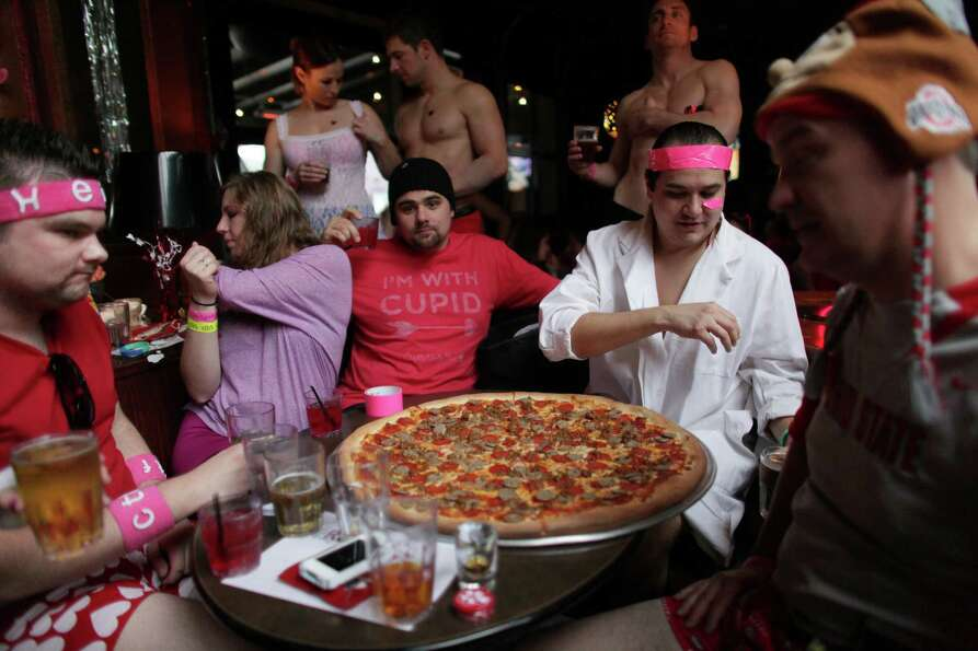 Participants order a pizza after running nearly one-mile duirng the Cupid's Undie Run.