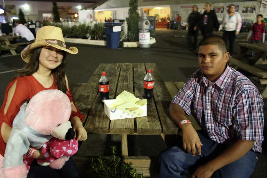 Rodeo goers enjoy the sights, sounds and tastes at the San Antonio Stock Show & Rodeo Saturday night, Feb. 9, 2013. Photo: Libby Castillo, For MySA.com
