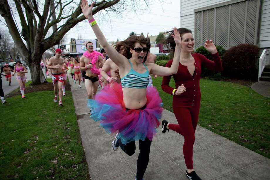 Participants run through Fremont during Cupid's Undie Run. Photo: JOSHUA TRUJILLO, SEATTLEPI.COM / SEATTLEPI.COM