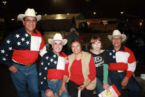 Rodeo goers enjoy the sights, sounds and tastes at the San Antonio Stock Show & Rodeo Saturday night, Feb. 9, 2013.