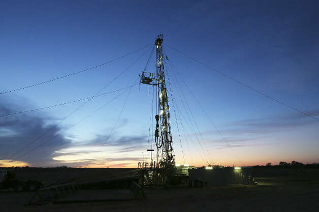 The sun sets on the drilling rig in Frio County, Sunday, Jan. 20, 2013. The drilling is funded by third generation wildcatter, Harvey Howell of San Antonio.