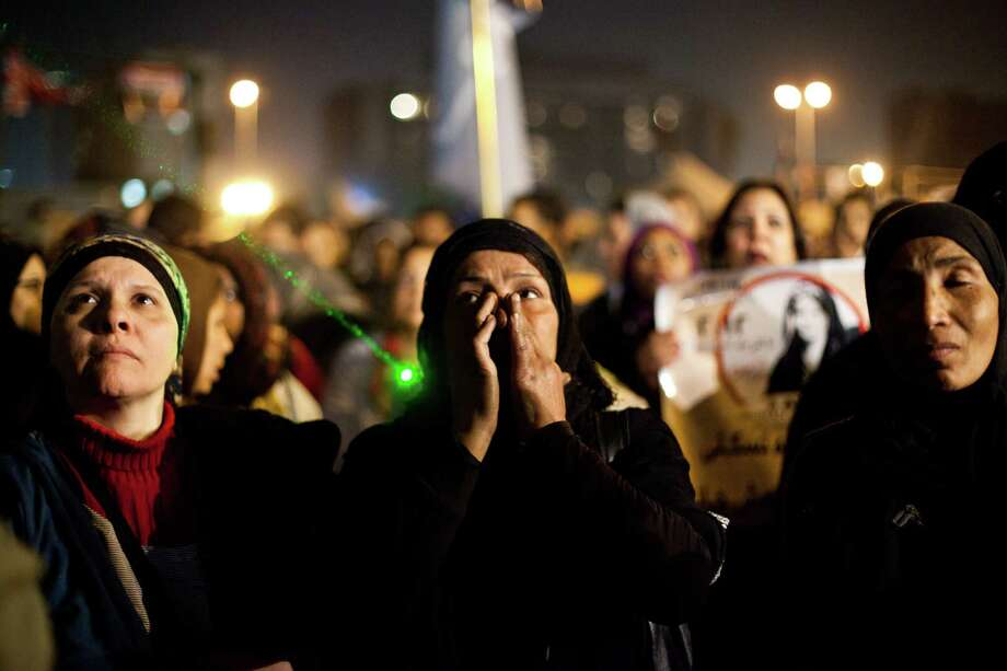 "Egyptian women gather to denounce sexual violence and harassment against women in Cairo, Egypt, Wednesday. Mob-led sexual assaults targeting Egypt's female protesters could increase if perpetrators are not punished, an international rights group warned on Wednesday. Amnesty International said statements from victims show that the assaults follow a ""clear pattern,"" where mobs of men encircle the victims, assault them with weapons and hands and then try to undress them. Amnesty's warning followed a statement from the U.N. human rights office, which last week said that about 25 women were reportedly sexually assaulted - in some cases with extraordinary violence - in Cairo's Tahrir Square during recent demonstrations against Egypt's Islamist President Mohammed Morsi. (AP/Virginie Nguyen Hoang) Photo: AP"