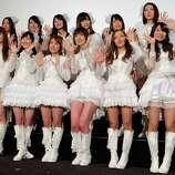 "The hugely popular Japanese girl band AKB48 members, from left in first row pose for photographers at the opening premiere of their new film ""Documentary of AKB48 No Flower Without Rain"" in Tokyo on Feb.1 one day after a group member shaved her head and issued a tearful videotaped apology for violating the megagroup's no-dating rule. The spectacle has sparked debate in Japan over whether the band AKB48 exerts too much control over its performers. Minami Minegishi made the video, posted on AKB48's website, after the 20-year-old was caught by a gossip magazine coming out of her boyfriend's apartment. AKB48 says it forbids its members from dating to project a clean image and signal their devotion to the group and their mostly male fans."