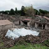 Debris of a collapsed house once used by gladiators to train before combat is protected from rain in the ancient Roman city of Pompeii, Italy. Work has begun to shore up Pompeii's fragile ruins, following several sensational collapses in the sprawling ancient Roman city. The tourist attraction near Naples is chronically short of state funds. Helping pay for the latest restoration is more than $55 million in European Union funds, which an EU commissioner, Johannes Hahn, in Pompeii Wednesday described as an important step toward rescuing the archaeological complex from modern-day ruin. In 2010, torrential rain caused the collapse of a wall in Pompeii, and a frescoed building where gladiators prepared for battle crumbled into a pile of dust.