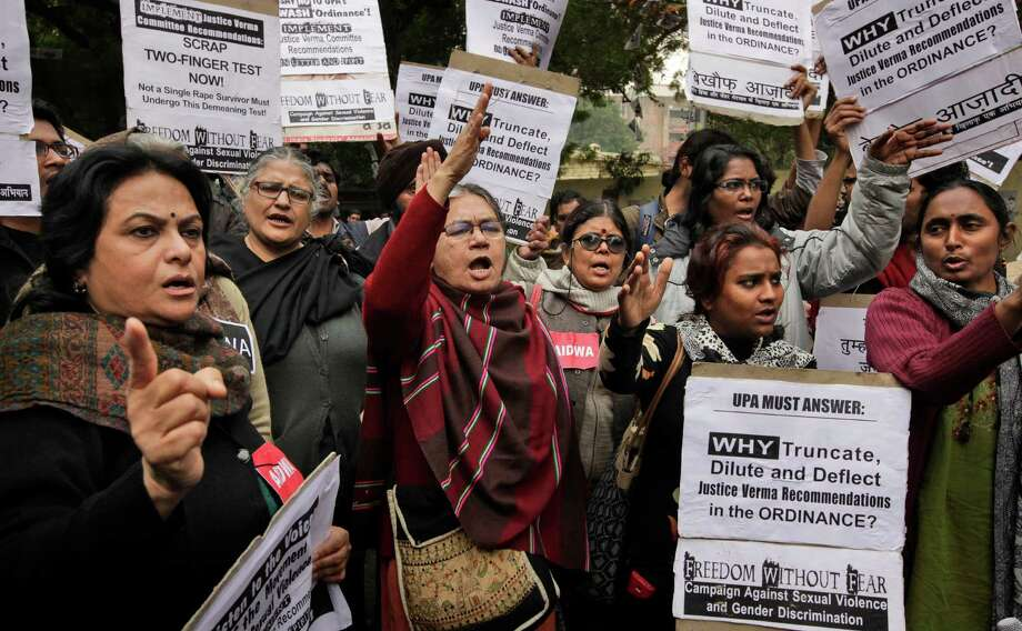 Activists from different women organizations shout slogan against government during a protest, in New Delhi, India, Monday. Scores of protesters have gathered near India's parliament house to protest a new law which they say is inadequate to deter all forms of sexual violence against women. Photo: AP