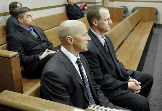 Attorney Patrick Mulligan, front, sits with former Boulder Police officers Samuel Carter, left, and Brent Curnow, right, during the filing of charges on Thursday at the Boulder County Jail in Boulder, Colo. Carter and Curnow are being charged for the killing of a bull elk on Mapelton Avenue in Boulder on Jan. 1. (AP Photo/The Daily Camera, Jeremy Papasso) Photo: AP