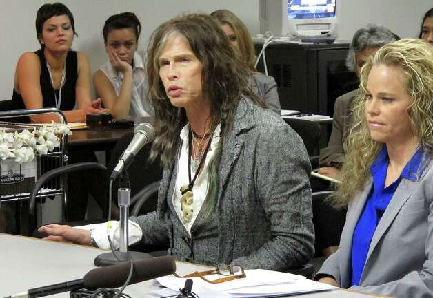 Aerosmith lead singer Steven Tyler testifies on celebrity privacy during a hearing at the Hawaii Capitol in Honolulu on Friday. Rock legends Steven Tyler and Mick Fleetwood convinced a Hawaii Senate committee on Friday to approve a bill to protect celebrities or anyone else from intrusive paparazzi. The state Senate Judiciary Committee approved the so-called Steven Tyler Act after the stars testified. The bill would give people power to sue others who take photos or video of their private lives in an offensive way. Photo: AP