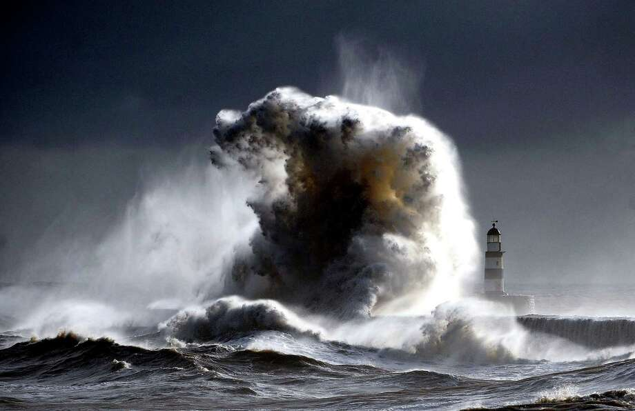Gale Force winds from the North make spectacular pictures at the harbour in Seaham, northeast England, as they batter the seafront, Wednesday. Many parts of Britain are braced for a predicted return of snow and gale force winds over the coming days. (AP Photo / Owen Humphreys, PA) Photo: AP