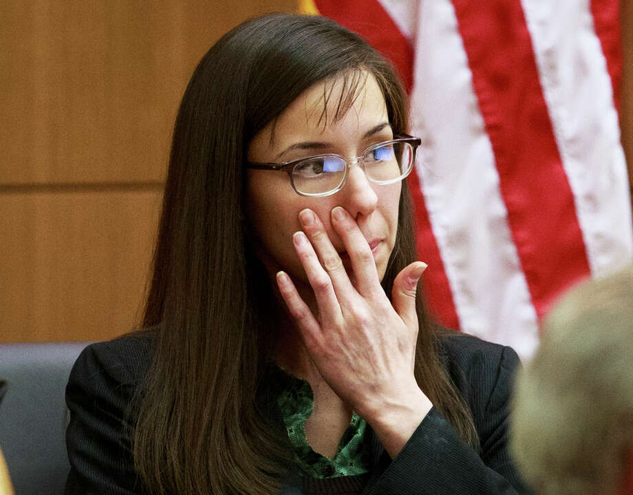 Defendant Jodi Arias pauses as she testifies in her murder trial in Judge Sherry Stephens' Superior Court, on Wednesday.  Arias, 32, is accused of stabbing and slashing Travis Alexander, 27 times, slitting his throat and shooting him in the head in his suburban Phoenix home in June 2008. She initially denied any involvement, then later blamed it on masked intruders before eventually settling on self-defense. Photo: AP