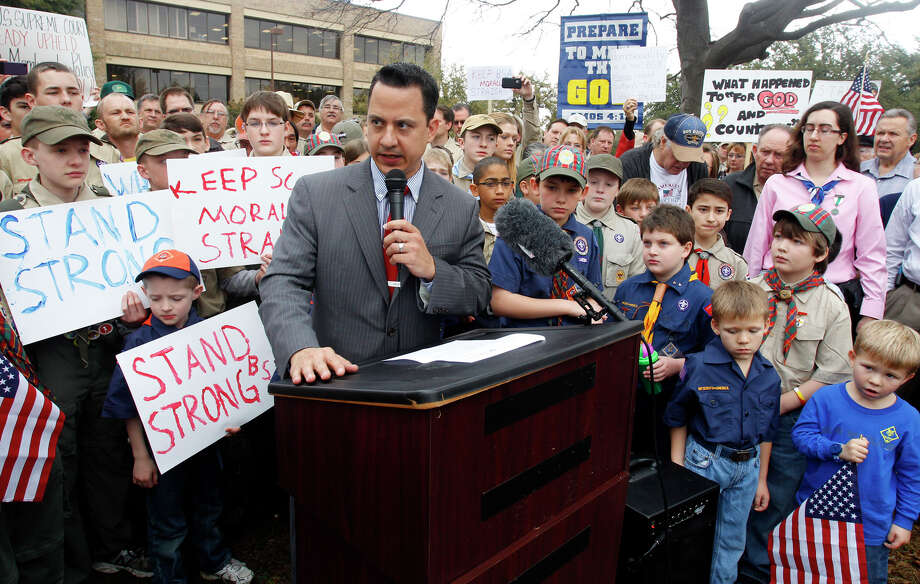 "Surrounded by area scouts, Jonathan Saenz, president of Texas Values, reads the press release to that crowd announcing that the Boy Scouts of America will be postponing its decision to admit gays at the ""Save Our Scouts"" Prayer Vigil and Rally in front of the Boy Scouts of America National Headquarters in Irving, Texas, Wednesday. Photo: AP"