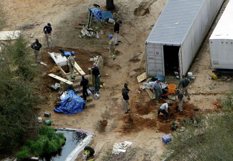 Authorities continue their investigation at the site in Midland City, Ala., on Friday where a five year old boy was held hostage in an underground bunker before being rescued Monday. Authorities shot and killed Jimmy Dykes after a week long standoff. The boy who was freed from an underground bunker is acting like a typical 5-year-old by all accounts, playing with toys and running around, but psychology experts and a woman who suffered through a similar ordeal warn there could be long-term emotional scars. Photo: AP