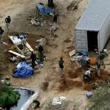 Authorities continue their investigation at the site in Midland City, Ala., on Friday where a five year old boy was held hostage in an underground bunker before being rescued Monday. Authorities shot and killed Jimmy Dykes after a week long standoff. The boy who was freed from an underground bunker is acting like a typical 5-year-old by all accounts, playing with toys and running around, but psychology experts and a woman who suffered through a similar ordeal warn there could be long-term emotional scars.