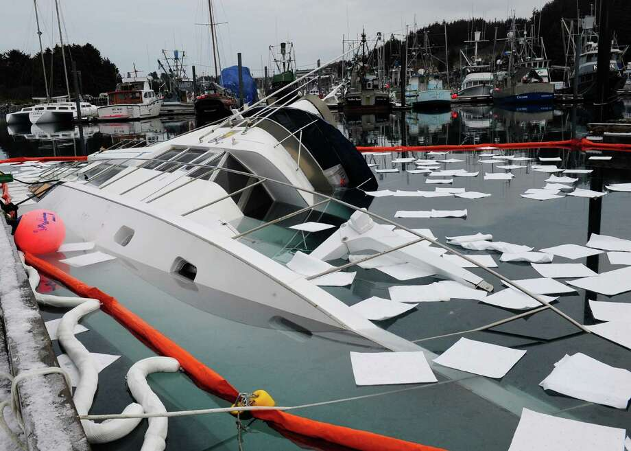 This undated image provided by the U.S. Coast Guard shows the U.S. Fish and Wildlife Service research vessel Arlluk after it sank at the pier in St. Herman's harbor in Kodiak, Alaska, Friday. Coast Guard Marine Safety Detachment Kodiak personnel responded to the sinking and are assisting with pollution mitigation and salvage of the vessel. Photo: AP