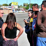 Yuma Police Sgt. Clint Norad talks with a group of concerned parents across the street from Salida Del Sol Elementary School, Tuesday in Yuma, Ariz. Salida Del Sol and Rancho Viejo Elementary were on lockdown after Yuma police responded to an unconfirmed report of a student possibly armed with a gun at Rancho Viejo.