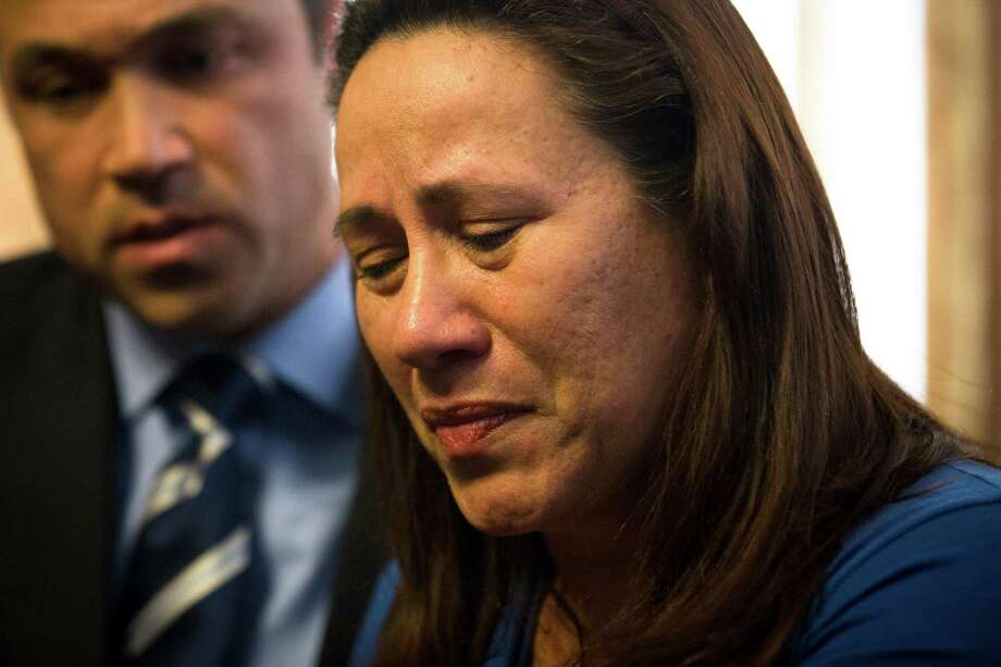 Betzaida Jimenez, mother of 33-year-old Sarai Sierra who was found dead on Saturday in Turkey, pauses during a news conference at a friend's home in Staten Island on Monday in New York. Sierra went missing while vacationing alone in Istanbul on Jan. 21, the day she was due to board her flight back home.Congressman Michael Grimm is at left. Photo: AP