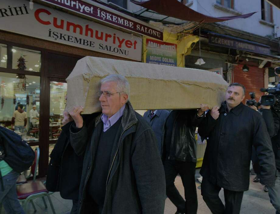 People carry the casket of murdered New York woman Sarai Sierra from the Surp Yerrortutyun church to an ambulances in Istanbul, Turkey, Wednesday. Sierra, a 33-year-old mother of two, went missing while vacationing alone in Istanbul. Her body was discovered late Saturday amid the city historical walls. Her body is expected to be sent back home, New York, on Thursday. Photo: AP