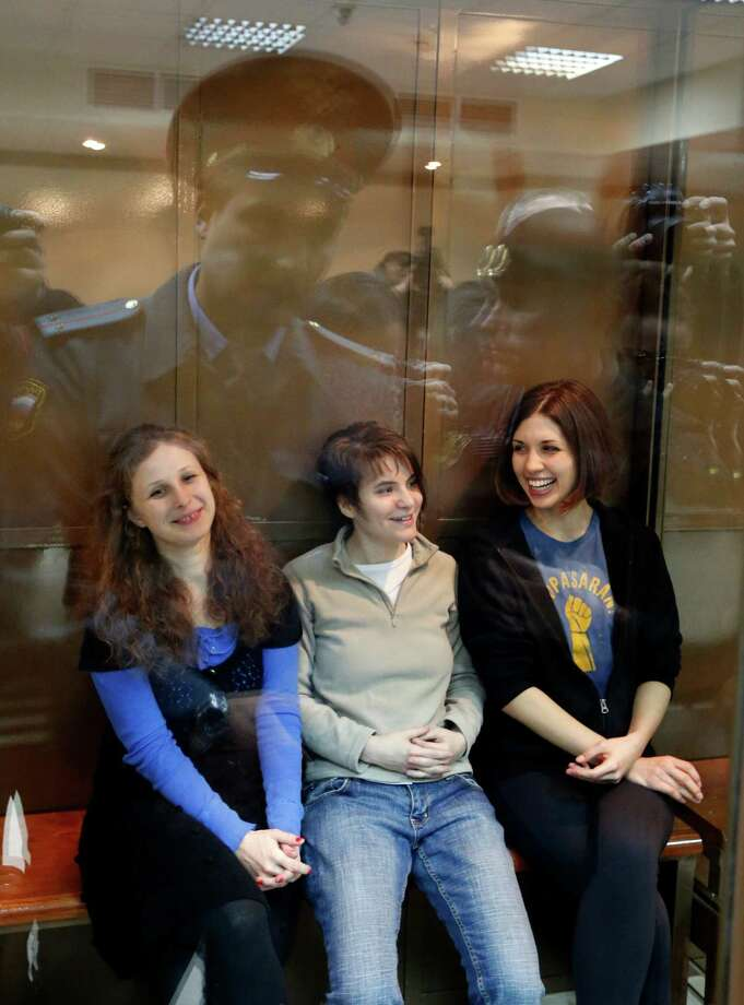 The Russian punk group Pussy Riot members - from left, Maria Alekhina, Yekaterina Samutsevich and Nadezhda Tolokonnikova - sit in a glass cage at a court room in Moscow, Russia, in 2012. Lawyers for three members of the feminist punk group Pussy Riot are contesting their conviction in the European Court of Human Rights in Strasbourg. The complaint filed Wednesday alleges the group's conviction violates four articles of the European Convention on Human Rights guaranteeing freedom of speech, the right to liberty and security, the prohibition of torture, and the right to a fair trial. Photo: AP