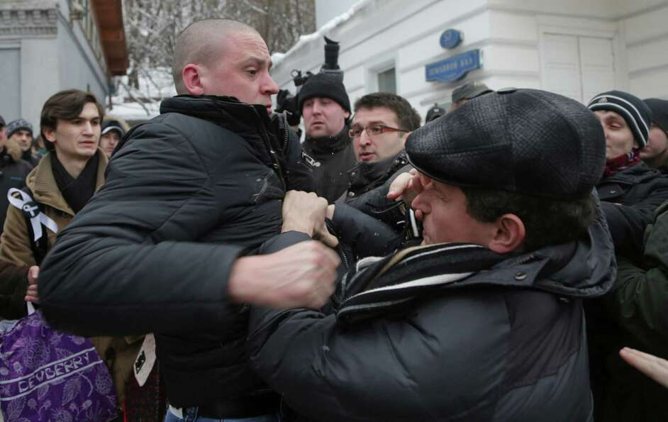 Opposition leader Sergei Udaltsov, left, fights with some of supporters of another opposition leader