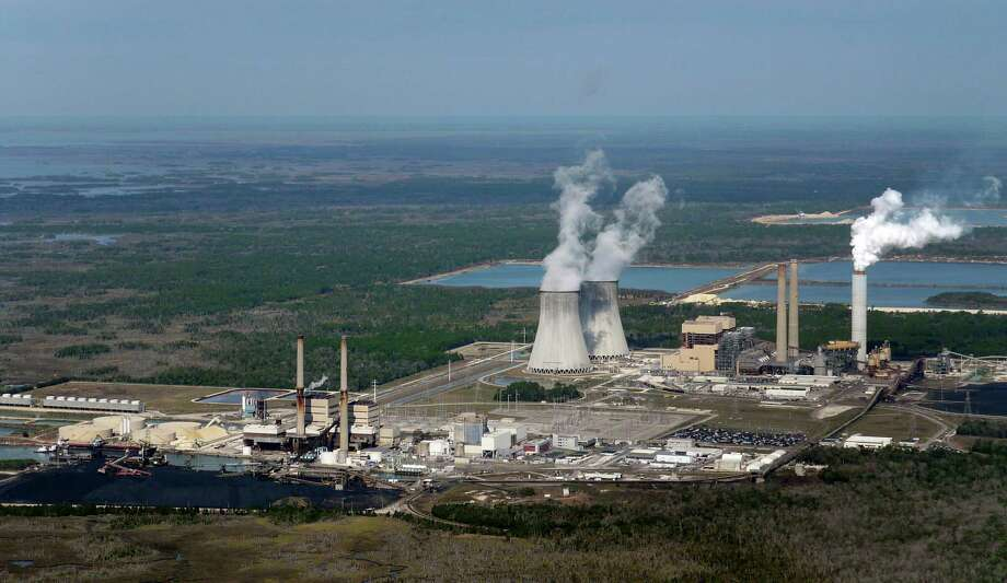 This aerial photo shows the crippled Crystal River nuclear plant in Crystal River, Fla., on Tuesday. Charlotte, N.C.-based Duke Energy said Tuesday it will permanently close the Crystal River plant after botched repairs and use $835 million from an insurance settlement to refund consumers forced to pay for higher-cost replacement power. (AP Photo/The Tampa Bay Times, Maurice Rivenbark) Photo: AP