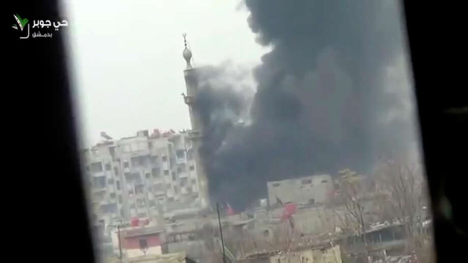 This image taken from video obtained from Ugarit News, which has been authenticated based on its contents and other AP reporting, shows smoke and fire billowing from an explosion in Damascus, Syria, Wednesday. Photo: AP