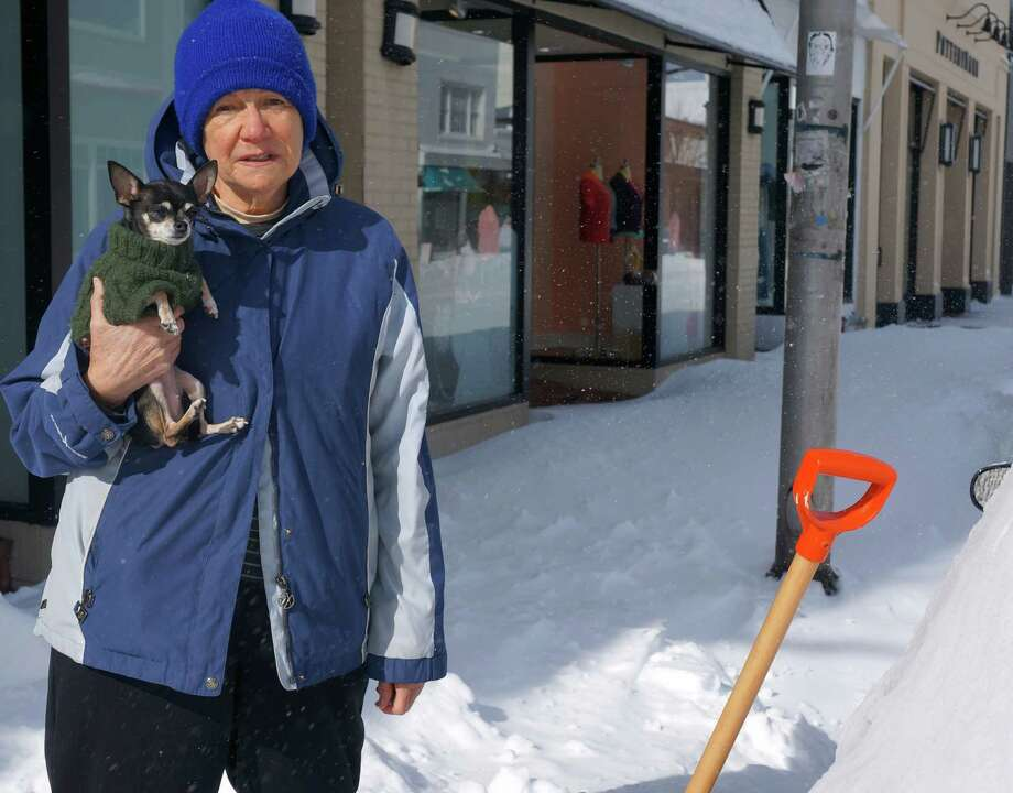 Luz Rios outside her Main Street apartment Saturday with her chihuahua, Nena. WESTPORT NEWS, CT 2/9/13 Photo: Paul Schott / Westport News