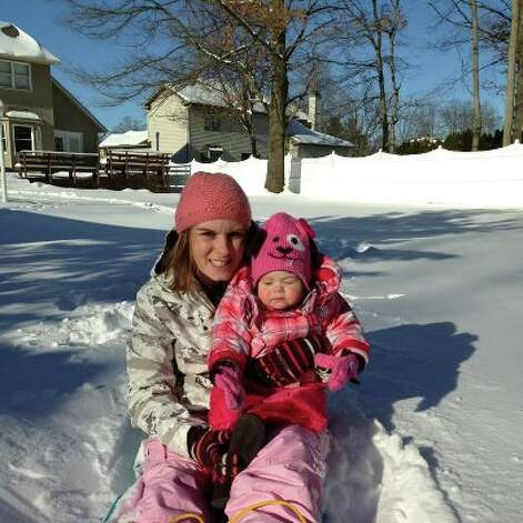 Getting pulled on the sled!  (Kailyn Leder) Photo: Reader-submitted