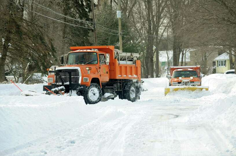Plows work in tandem to clearKatona Dr. in Fairfield, Conn. on Saturday, Feb. 9, 2013.