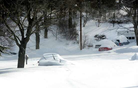 What's the point in digging out if your street is not plowed like this one, Shalimar Lane in Fairfield, Conn. on Saturday, Feb. 9, 2013. An overnight blizzard dumped over two feet of snow in the area. Photo: Cathy Zuraw / Connecticut Post