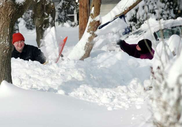 Residents on Bel Air Lane dig out after a overnight blizzard dumped over two feet of snow in Fairfield, Conn. on Saturday, Feb. 9, 2013. Photo: Cathy Zuraw / Connecticut Post