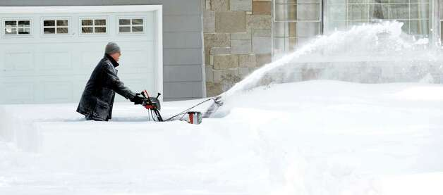 A resident on High Street clears his driveway after a overnight blizzard dumped over two feet of snow in Fairfield, Conn. on Saturday, Feb. 9, 2013. Photo: Cathy Zuraw / Connecticut Post