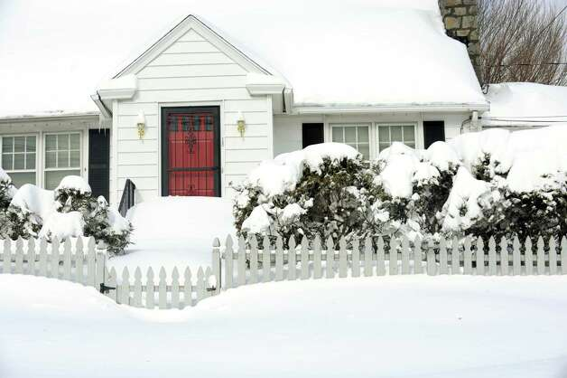 Southwestern Connecticut was hit by one of the biggest snowstorms in history leaving homes like this one on Meadowcroft Rd. in Fairfield Conn. buried in snow on Saturday Feb. 9, 2013. Photo: Cathy Zuraw / Connecticut Post