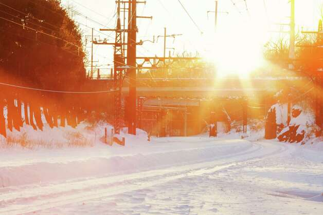 Glittering sun over the snow-covered railroad tracks in the Southport section of town -- one reason that Metro-North Railroad service east of Stamford was suspended for a second day on Sunday.  FAIRFIELD CITIZEN, CT 2/10/13 Photo: Ute-Christin Cowan / Fairfield Citizen contributed