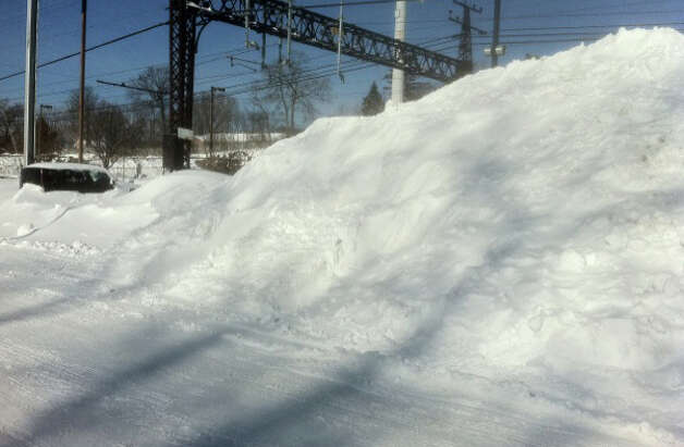 There's a car -- actually, two -- buried in that towering mound of snow plowed into a corner of the downtown Fairfield Railroad Station.  FAIRFIELD CITIZEN, CT 2/10/13 Photo: John Schwing / Fairfield Citizen contributed