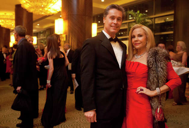 Bob Nowak and Carolyn Farb, right, during the Houston Heart Ball at the Hilton Americas Houston Saturday, February 9, 2013 in Houston. Photo: Alyssa Orr, Houston Chronicle / © 2013 Alyssa Orr