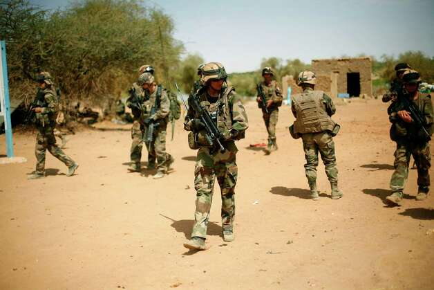 French soldiers secure the area where a suicide bomber attacked, at the entrance of  Gao, northern Mali, Sunday. It was the second time a suicide bomber targeted the Malian army checkpoint in three days. Photo: AP