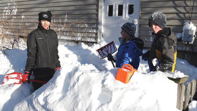 Phillip Lauterborn teams with Spencer and Elliot Dolzani to make a snow fort late Saturday afternoon.  FAIRFIELD CITIZEN, CT 2/10/13 Photo: Mike Lauterborn / Fairfield Citizen contributed
