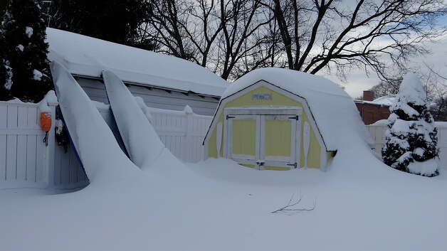 Kayaks and a shed in the beach area half buried with snow Saturday morning.  FAIRFIELD CITIZEN, CT 2/10/13 Photo: Mike Lauterborn / Fairfield Citizen contributed