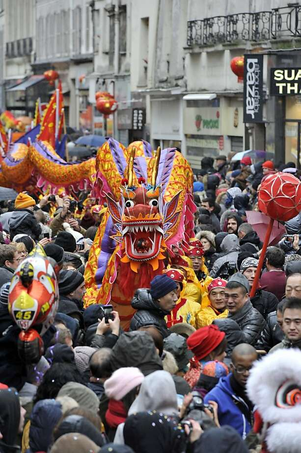 Performers surrounded by the crowd hold a dragon as they dance during a parade in Paris on February 10, 2013, to celebrate Chinese New Year. Chinese communities world wide traditionally welcomed in the 'Year of the Snake'.  Photo: Mehdi Fedouach, AFP/Getty Images