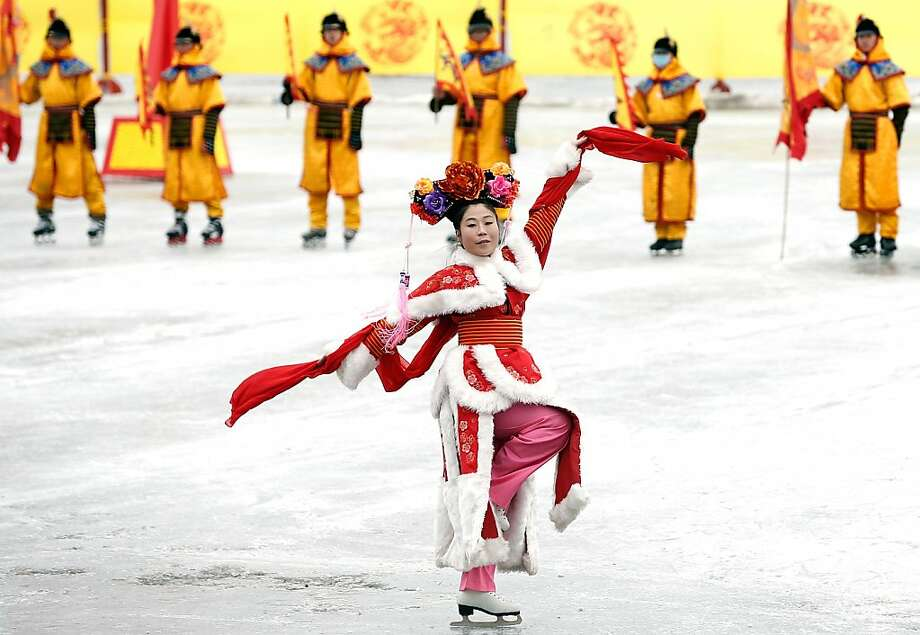 Chinese folk artists perform a play on ice during the Spring Festival Temple Fair on February 10, 2013 in Beijing, China. The Chinese Lunar New Year of the Snake also known as the Spring Festival, which is based on the Lunisolar Chinese calendar, is celebrated from the first day of the first month of the lunar year and ends with the Lantern Festival on the Fifteenth day. Photo: Lintao Zhang, Getty Images