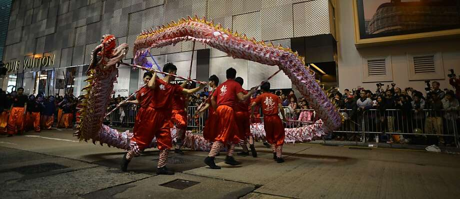 Participants take part in the Chinese lunar new year parade in the streets of Hong Kong on February 10, 2013. Chinese lunar new year, celebrated by Chinese communities the world over, falls on February 10 with the beginning of the new moon. Photo: Antony Dickson, AFP/Getty Images