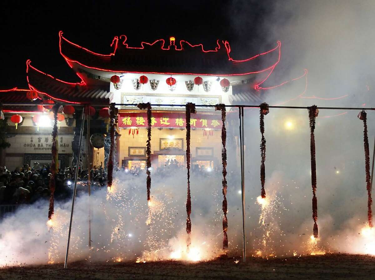 People light firecrackers in celebration of the Chinese and Vietnamese Lunar New Year, in Los Angeles, Sunday, Feb 10, 2013.
