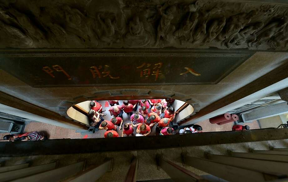 Chinese-Filipinos pray at the Seng Guan Temple during the celebration of the Chinese Lunar New Year marking the start of the Year of the Snake in Manila's China town on February 10, 2013, as billions of Chinese worldwide celebrate the occasion. Photo: Jay Directo, AFP/Getty Images