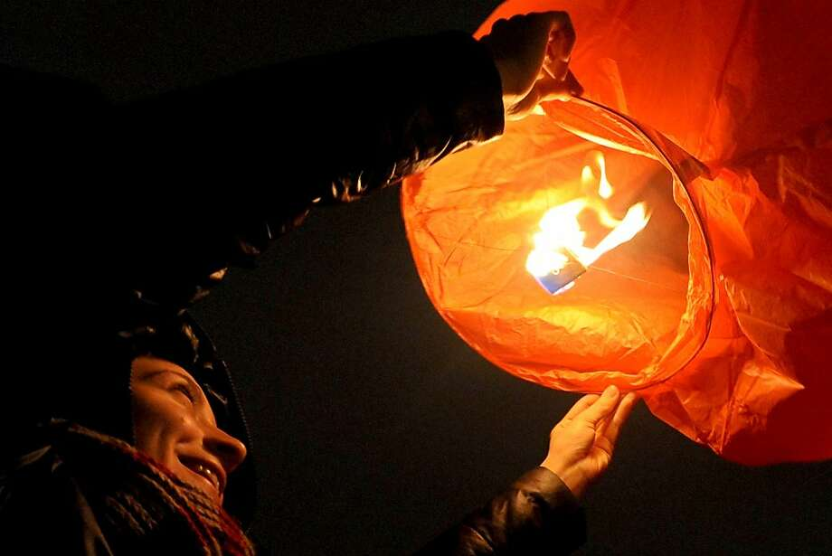 People light a Chineese sky lantern in St. Petersburg late on February 9, 2013 during celebrations marking the start of the Chinese lunar new year and year of the snake on February 10. Photo: Olga Maltseva, AFP/Getty Images