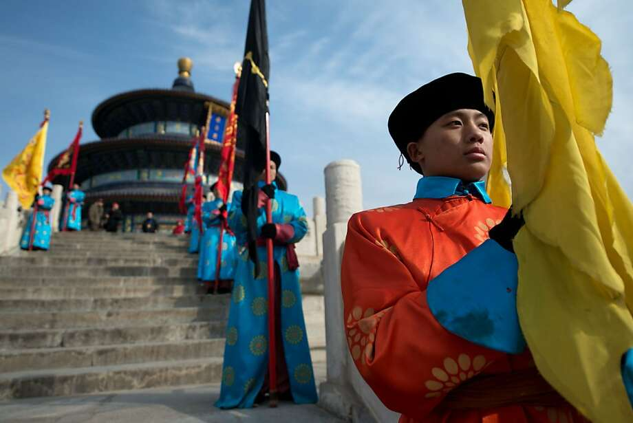 Performers take part in a traditional Qing Dynasty ceremony in which emperors prayed for good fortune, during lunar new year festivities at the temple of Heaven in Beijing on February 10, 2013. A billion-plus Asians ushered in the Year of the Snake with a cacophony of fireworks and ceremonies to kick off a week of festivities. Photo: Ed Jones, AFP/Getty Images